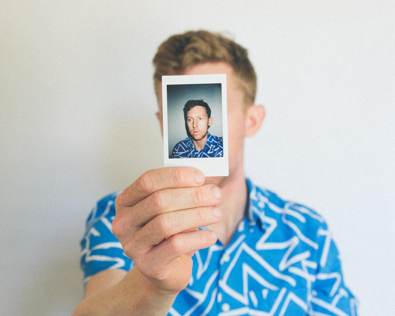 man showing photo of him